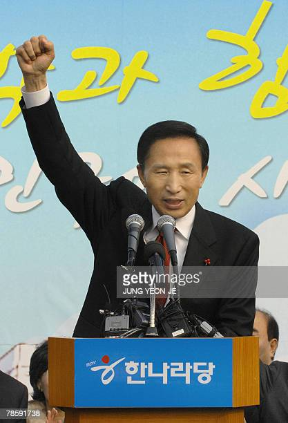 South Korean presidentelect Lee MyungBak raises his fist as he speaks during a disbanding ceremony for the Grand National Party election committee at...