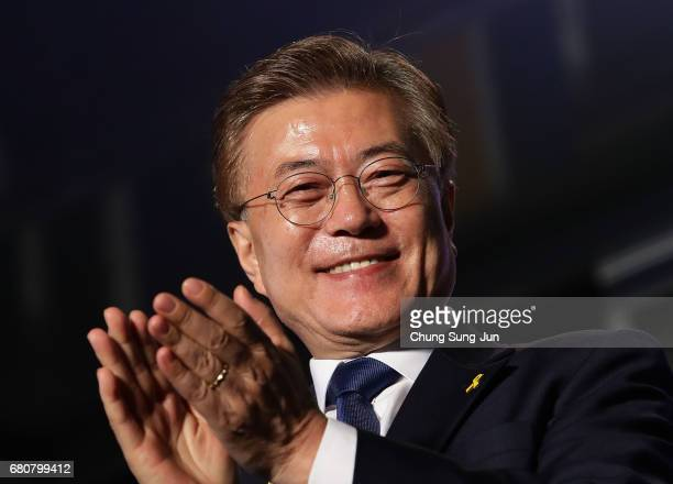South Korean President-elect Moon Jae-in, of the Democratic Party of Korea, celebrates with supporters at Gwanghwamun Square on May 9, 2017 in Seoul,...