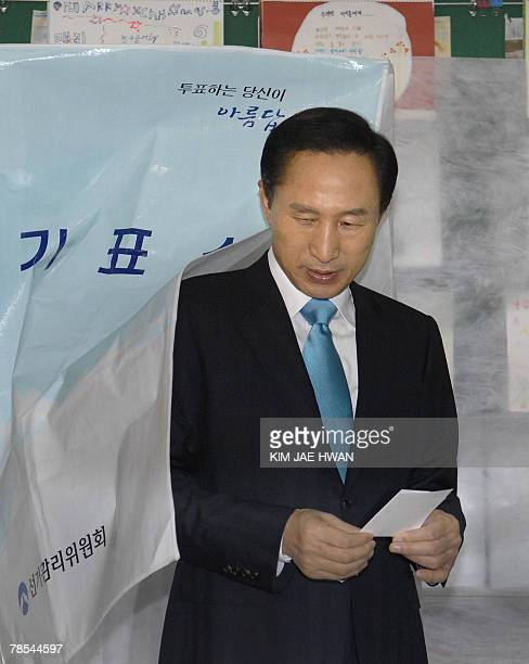 South Korean presidential candidate Lee MyungBak of the opposition Grand National Party exits the voting booth to cast his ballot in the presidential...