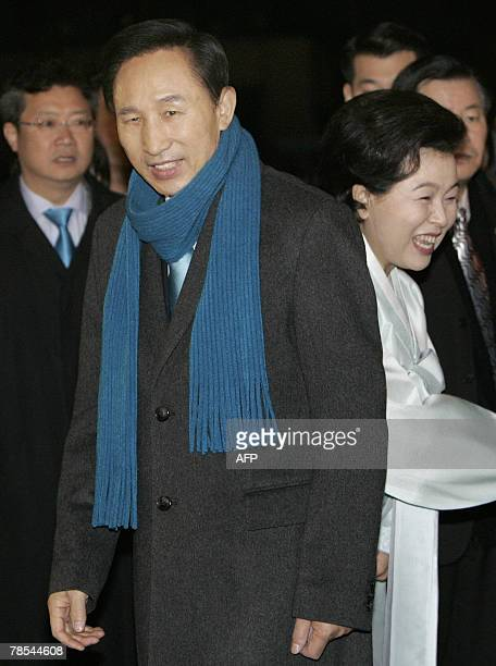 South Korean presidential candidate Lee MyungBak of the opposition Grand National Party arrives with his wife Kim YoonOk to cast his vote in the...