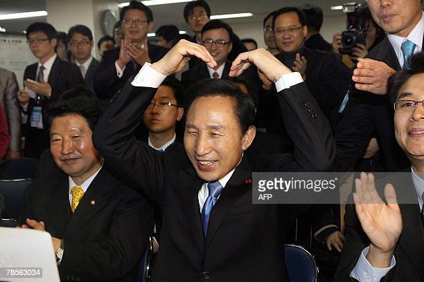 South Korean presidential candidate Lee MyungBak of the opposition Grand National Party gestures as he takes part in a video conference with party...