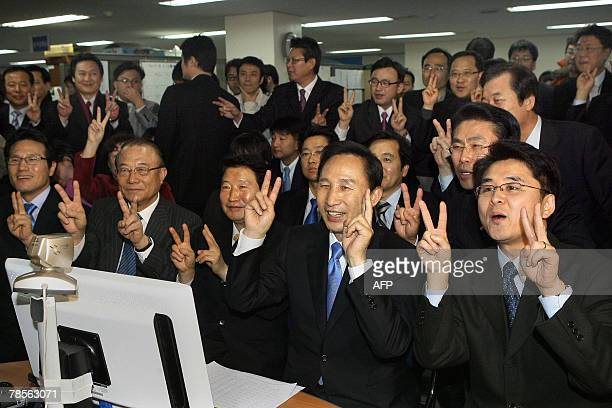 South Korean presidential candidate Lee MyungBak of the opposition Grand National Party flashes a victory sign which also matches Lee's place on the...