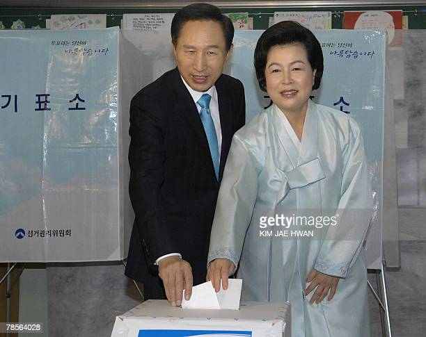 South Korean presidential candidate Lee MyungBak of the opposition Grand National Party and his wife Kim YoonOk cast their ballots in the...