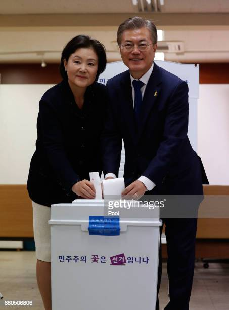 South Korean presidential candidate Moon Jaein of the Democratic Party and his wife Kim Jungsuk prepare to cast their ballot for a presidential...