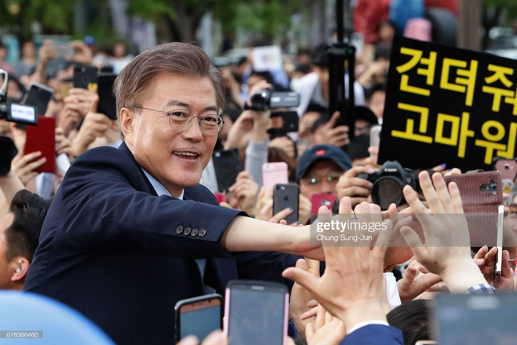 COVID-19 Success: South Korea President Moon Jae-In greeting voters