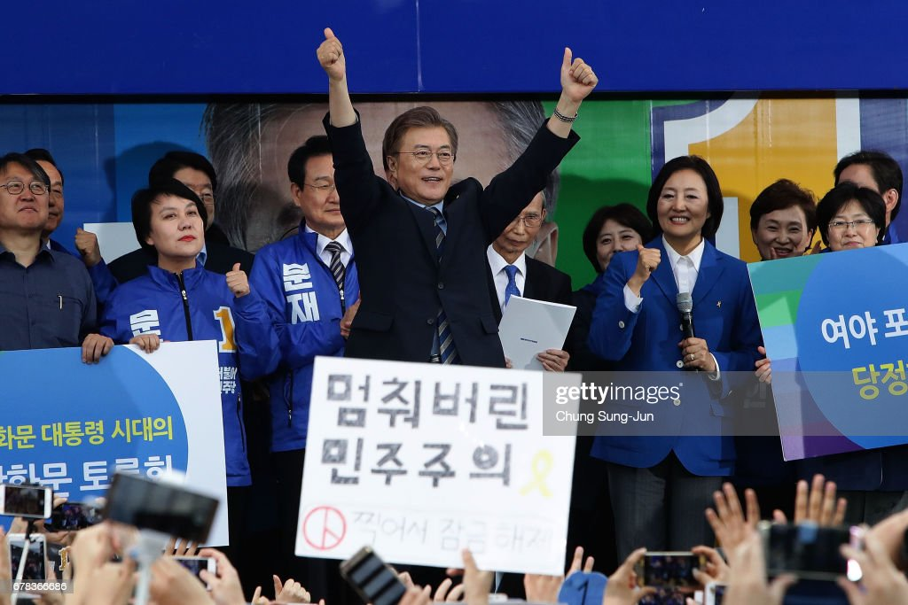 South Korean presidential candidate Moon Jae-in of the Democratic Party of Korea, is greeted by his supporters during a presidential election campaign on May 4, 2017 in Goyang, South Korea. Preliminary voting has started at local polling stations across South Korea prior to the primary Presidential election on May 9.