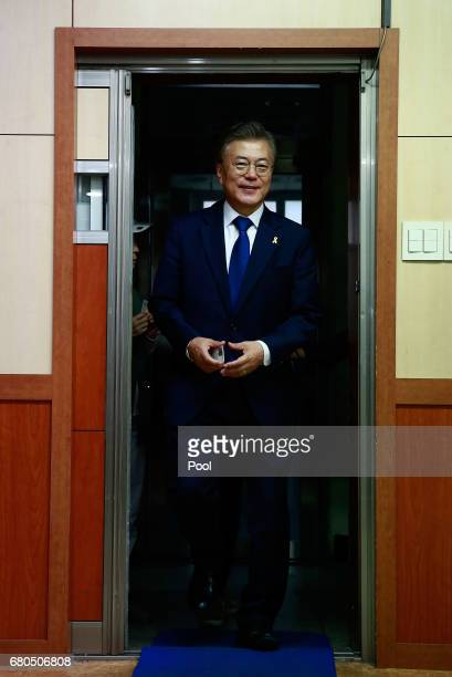 South Korean presidential candidate Moon Jaein of the Democratic Party walks to cast his ballot for a presidential election at a junior high school...