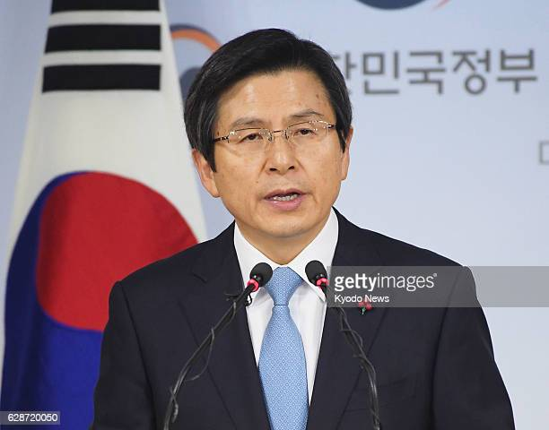 South Korean Prime Minister Hwang Kyo Ahn delivers an address to the nation as acting president in Seoul on Dec 9 after the country's parliament...