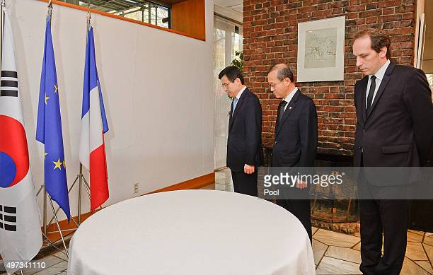 South Korean Prime Minister Hwang KyoAhn pays a tribute with French ambassador to South Korea Fabien Penone following the recent terror attacks in...