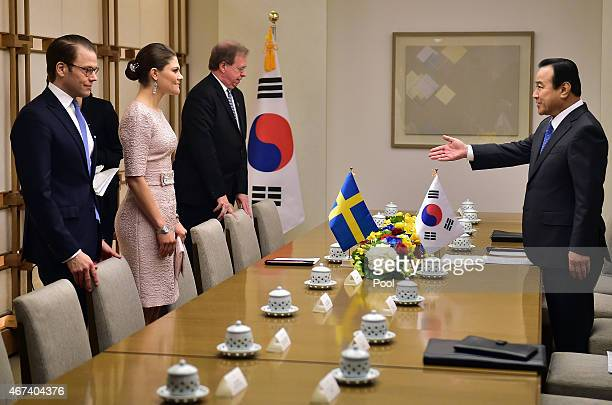 South Korean Prime Minister Lee WanKoo ushers Crown Princess Victoria of Sweden and Prince Daniel of Sweden during their meeting at Lee's official...