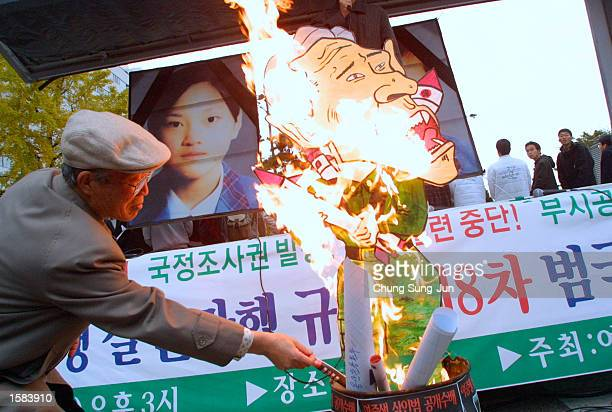 South Korean protester burns an effigy of US President George W Bush at an antiUS rally November 2 2002 in Seoul South Korea Approximately 500...