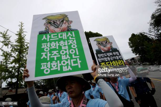 South Korean protester hold antiUS placards at a rally against the deployment of the Terminal HighAltitude Area Defense near the US army base on...