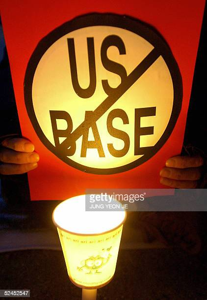 South Korean protester holds a placard during an antiUS rally near a US military base in Pyeongtaek 19 March 2005 opposing the relocation of US...