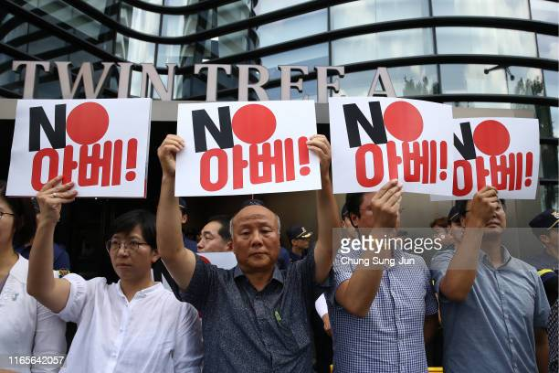 South Korean protester holds a placard reading No Abe during a protest against Japan's decision to remove South Korea from a whitelist of favoured...