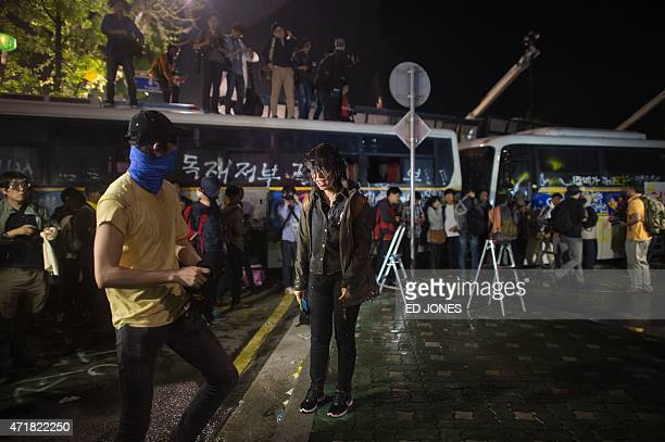 South Korean protesters are sprayed by a water cannon as they try to march toward the presidential house during a rally demanding a fully independent...