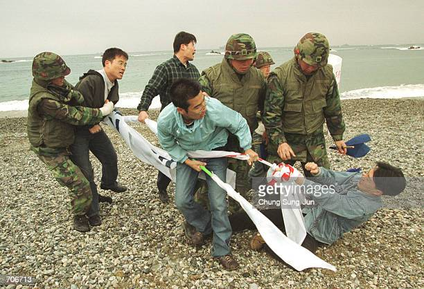 South Korean protesters attempt to pull up a banner as South Korean soldiers attempt to take it away March 22 2002 during the US and South Korea...