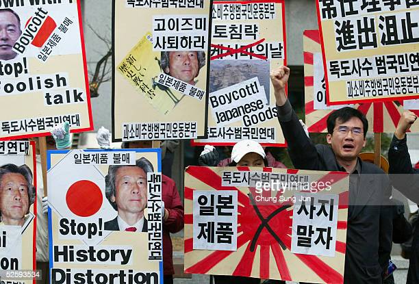 South Korean protesters hold antiJapanese posters during a protest against Japan's sovereignty claims over the Dokdo islets which South Korea...