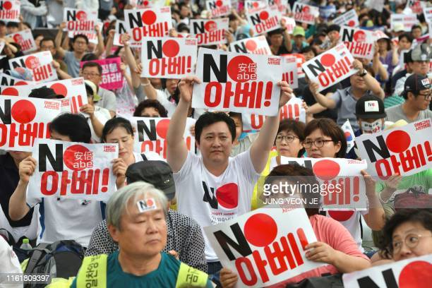 South Korean protesters hold signs reading No Abe during an antiJapanese rally marking the anniversary of Korea's liberation from Japan's 191045...