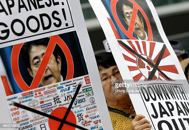 South Korean protesters participate in a demonstration as South Korea marks the 70th Independence Day in front of Japanese embassy on August 15 2015...