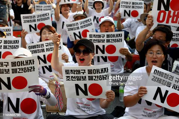 South Korean protesters participate in a rally to denounce Japan's new trade restrictions on South Korea in front of the Japanese embassy on August...