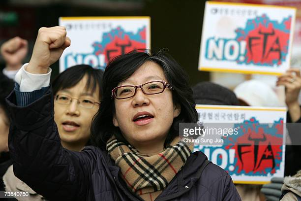 South Korean protesters shout slogans during their protest against free trade agreement talks between South Korea and the United States on March 10...