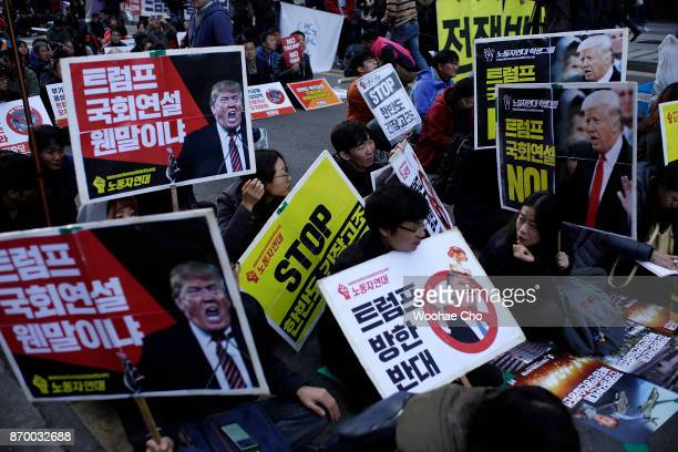 South Korean protesters take part in an antiTrump rally in front of US Embassy on November 4 2017 in Seoul South Korea Trump will visit South Korea...