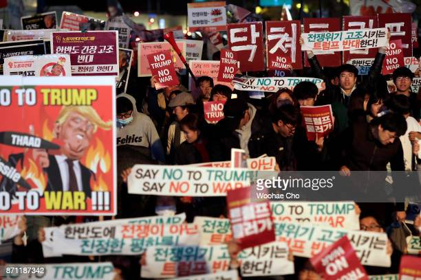 South Korean protesters take part in an antiTrump rally in front of the US Embassy on November 7 2017 in Seoul South Korea Trump is in South Korea as...