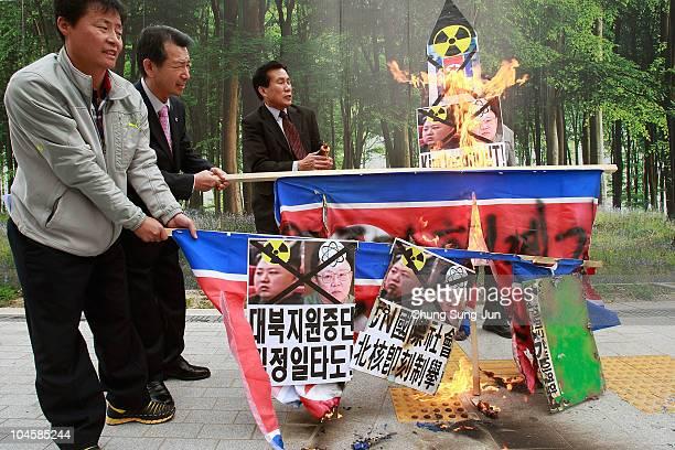 South Korean protestors burn portraits of North Korean leader Kim JongIl his son Kim JongUn and North Korean flag at a rally opposing recent...