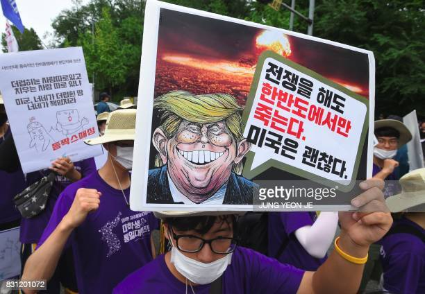 South Korean protestors hold placards showing a caricature of US President Donald Trump during an antiUS rally to condemn Trump outside a US Army...