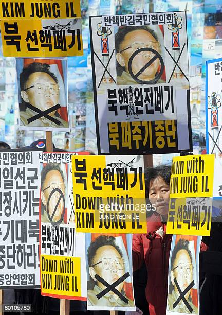 South Korean protestors hold placards showing a picture of North Korean leader Kim JongIl during an antiNorth Koran rally to mark the March First...