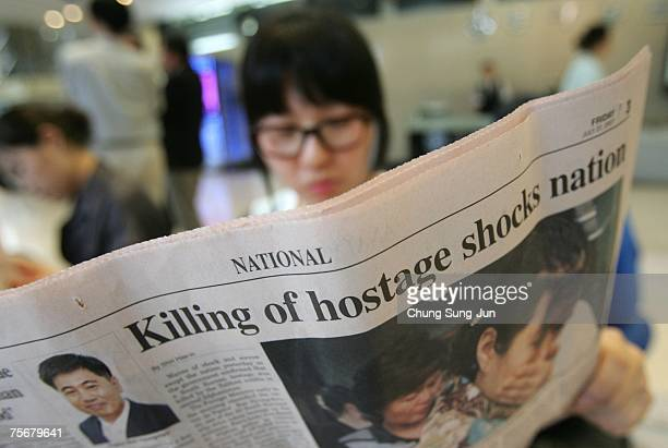 South Korean reads a newspaper reporting on the kidnapped South Koreans in Afghanistan July 26 2007 in Seoul South Korea Afghan police yesterday...
