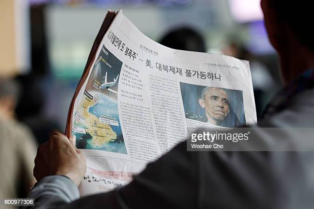 South Korean reads a newspaper reporting the North Korea's nuclear test at the Seoul Railway Station on September 9, 2016 in Seoul, South Korea....
