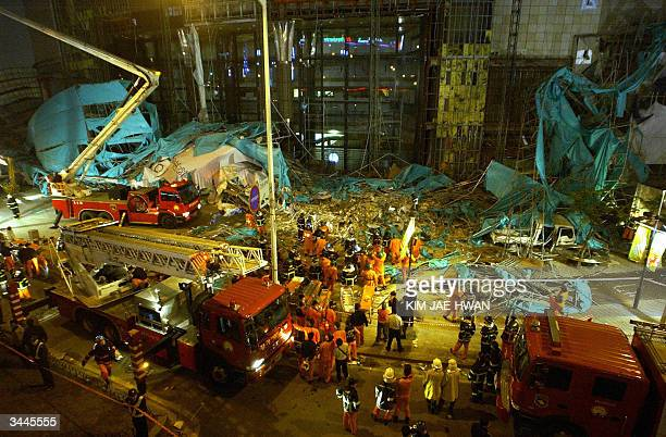 South Korean rescue workers rescue a scaffolding collapsed at a local department store under repair in Bucheon on the western outskirts of Seoul 20...