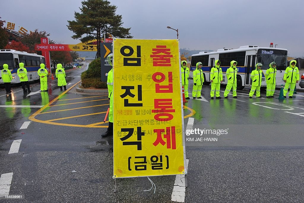 South Korean riot police block the entrance of Imjingak Park on the border near the town of Paju, around 60 kilometres north of Seoul on October 22, 2012. South Korean troops and riot police prevented activists from launching anti-Pyongyang leaflets across the border, after North Korea threatened a 'merciless' military response.