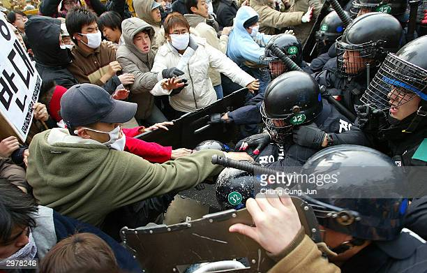 South Korean riot police clash with protesters during an antiwar rally in front of the National Assembly on February 13 2004 in Seoul South Korea...