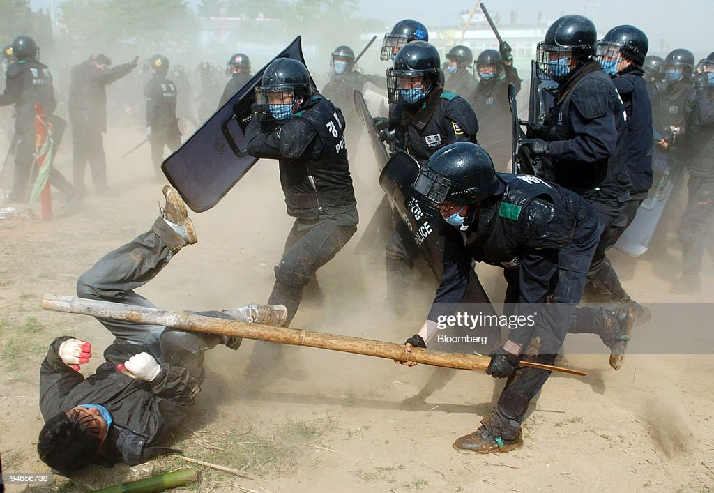 South Korean riot police use force to break up a protest in : News Photo