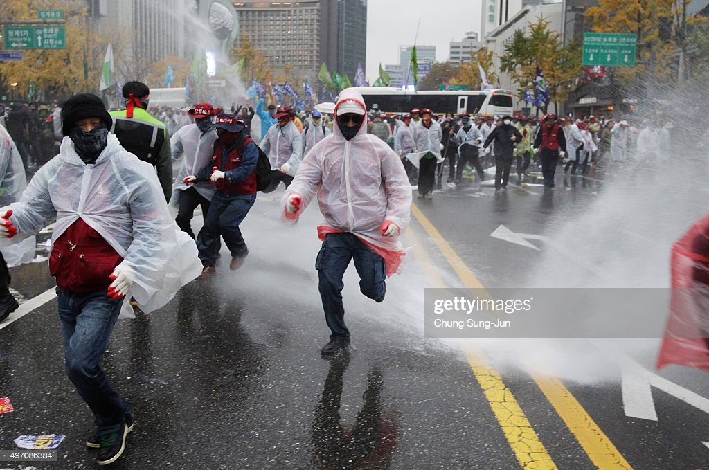 South Korean riot police use pepper water cannon to stop the protesters march towards Presidential house during a rally on November 14, 2015 in Seoul, South Korea. Tens of thousands of members of liberal civic groups including labor union workers and students across the nation gathered to protest against the introduction of new history textbook and other government policies.