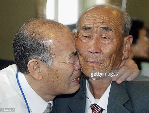 South Korean Ryu JungHoon bids a farewell to his North Korean elder brother Ryu ChangHee as they finish a threeday family reunion between the South...