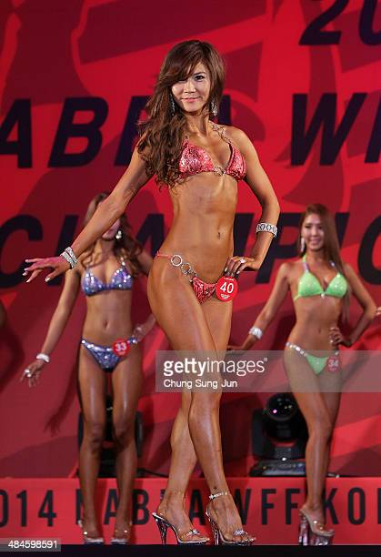 South Korean Seok HyunHye performs in the WFF Miss Bikini competition during the 2014 NABBA/WFF Korea Championship on April 13 2014 in Daegu South...