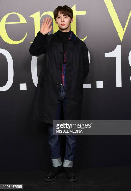 South Korean singer Hwang Minhyun arrives to attend the Moncler women's Fall/Winter 2019/2020 collection fashion show on February 20 2019 in Milan