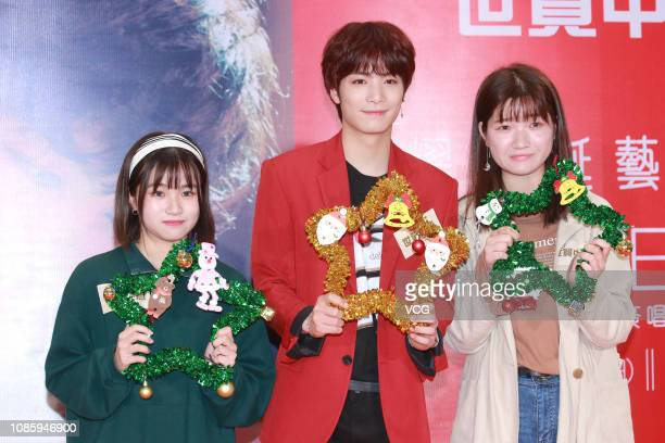 South Korean singer JR of boy group NU'EST W poses with fans during a signing session for fans at Causeway Bay on December 23 2018 in Hong Kong China