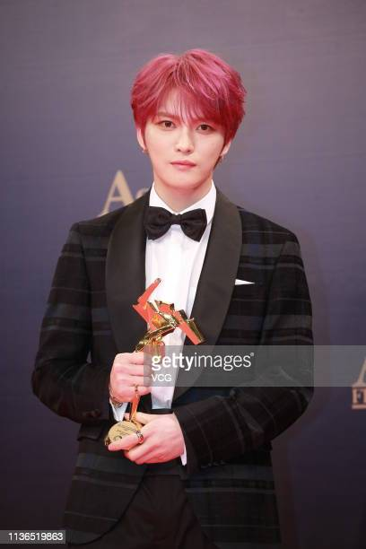 South Korean singer Kim Jaejoong poses backstage during the 13th Asian Film Awards on March 17 2019 in Hong Kong China