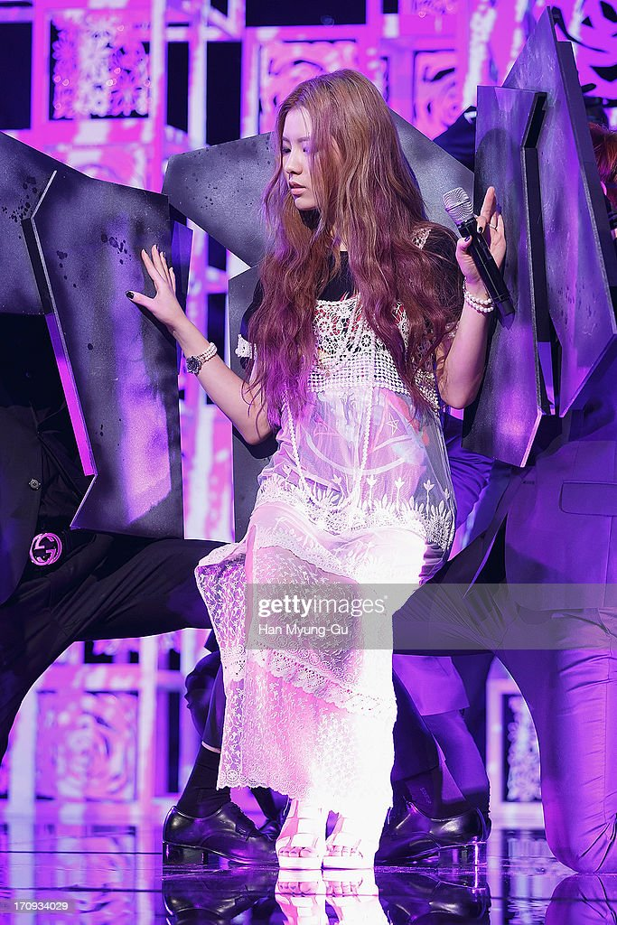 South Korean singer Kim Lim performs onstage during the Mnet 'M CountDown' at CJ E&M Center on June 20, 2013 in Seoul, South Korea.