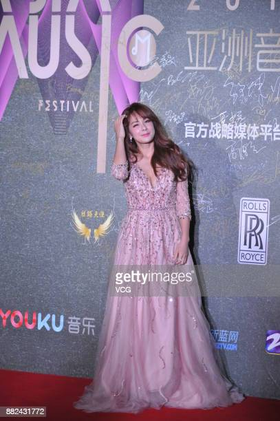 South Korean singer Lee ChaeYeon poses on the red carpet of 2017 Asia Music Festival on November 29 2017 in Shanghai China
