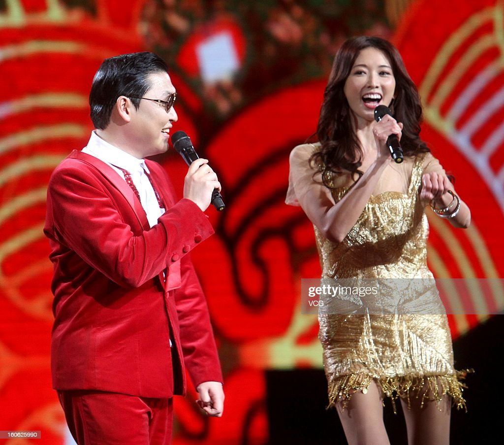 South Korean singer Psy and Chiling Lin perform on stage on February 1, 2013 in Shanghai, China.