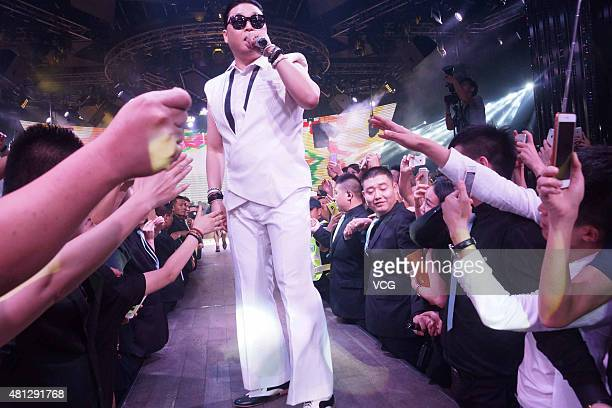 South Korean singer Psy Park Jaesang performs on the stage at a bar on July 18 2015 in Hangzhou China