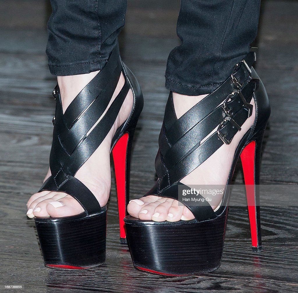 South Korean singer Seo In-Young (shoe detail) performs onstage live during her mini album 'Forever Young' Showcase on May 14, 2013 in Seoul, South Korea.
