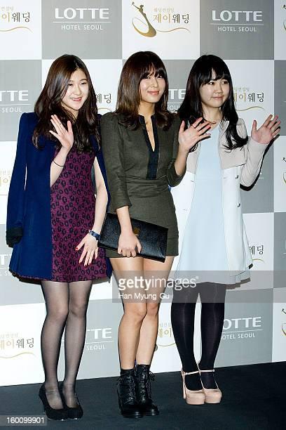 South Korean singers Baek YeRin Kim Yubin of girl group Wonder Girls and Park JiMin attend the wedding of Sun of Wonder Girls at Lotte Hotel on...