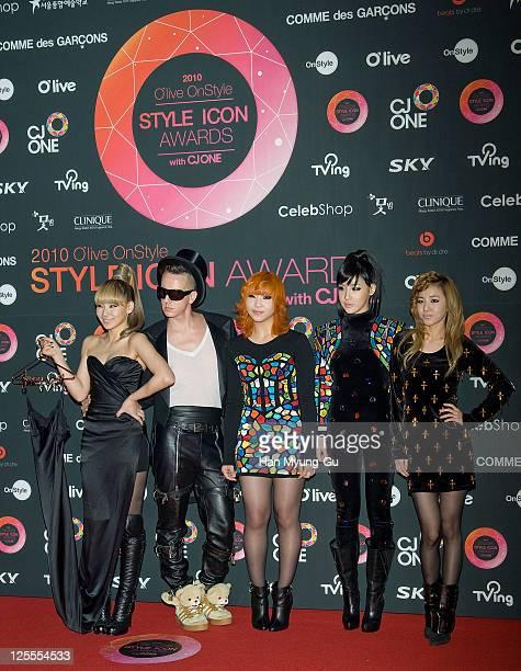 South Korean singers Lee ChaeRin Gong MinJi Park Bom Sandara Park of 2NE1 and fashion disigner Jeremy Scott pose for the media at the 2010 Style Icon...