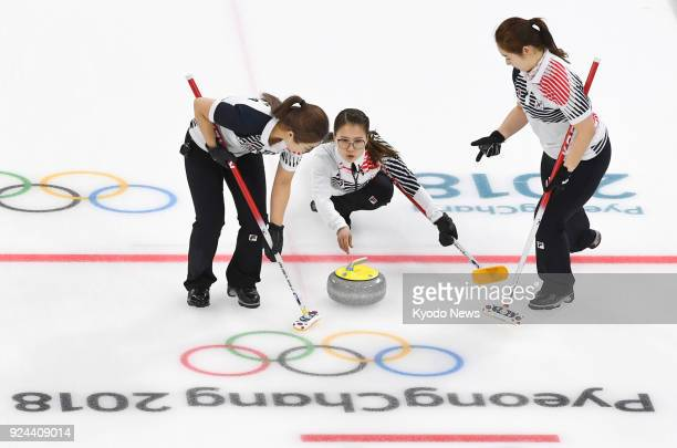 South Korean skip Kim Eun Jung releases a stone during the seventh end of the women's curling final against Sweden at the Pyeongchang Winter Olympics...